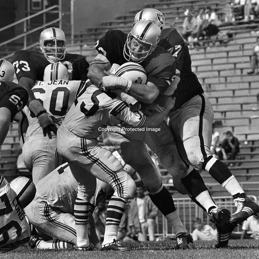 Oakland Raiders Ben Davidson along Mwith teammates sack Patroits QB #15 (photo by Ron Riesterer)