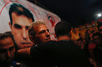 Family and friends of ASMAT MANSOUR (C) celebrate his release  from Israeli detention in the village of  Dir Jarir in the west bank, on August 14, 2013. The release of the prisoners, all but one of whom were jailed before the Palestinian Authority was formed in 1994, has been hailed by Palestinian negotiators but has incensed some Israeli officials. Photo by Oren Nahshon