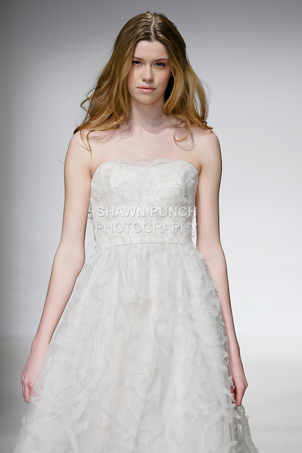Model walks runway in an Amria wedding dress by Amsale Aberra, for the Christos Spring 2012 Bridal runway show.