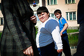 Dzhambulat Khotokhov, 6, one of the fattest boys in the world, walks with his 14-year-old brother in their home town Terek, in southern Russia. .Now 1.4 metres tall and weighing about 100 kg, Khotokhov has grabbed world attention as the biggest kid in the world since he was three. .Khotokhov lives with his mother Neyla and his brother, 14-year-old Mukha. .