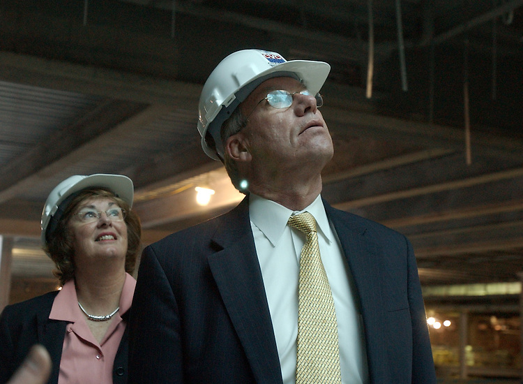 Sen. Wayne Allard, R-Colo., and his wife Joan look through a skylight up to the Capitol Dome, during a tour of the Capitol Visitor Center constuction site, by Architect of the Captiol, Alan Hantman.