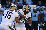15 November 2014: Pitt's Chad Voytik (16) hands off to Rachid Ibrahim (29). The University of North Carolina Tar Heels hosted the University of Pittsburgh Panthers at Kenan Memorial Stadium in Chapel Hill, North Carolina in a 2014 NCAA Division I College Football game. UNC won the game 40-35.