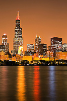 Chicago skyline at night high resolution photo with Lake Michigan lakefront and downtown city buildings including 311 South Wacker Drive Building, Sears Tower / Willis Tower (233 South Wacker Drive), Hilton Chicago (720 South Michigan Avenue), Renaissance Blackstone Hotel (636 S. Michigan Avenue), The Congress Plaza Hotel (520 South Michigan Avenue), Franklin Center / AT&T Corporate Center (227 West Monroe Street), Roosevelt University Building (425 South Wabash Avenue), CNA Center Building (333 South Wabash Avenue).