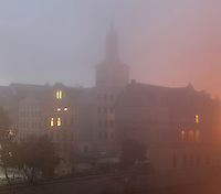 The Bedrich Smetana Museum seen through the early morning mist from the Charles Bridge or Karluv most, across the Vltava river, Prague, Czech Republic. The historic centre of Prague was declared a UNESCO World Heritage Site in 1992. Picture by Manuel Cohen