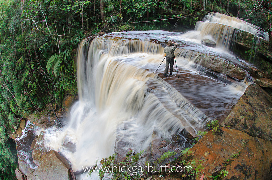Alex Hyde photographing Gulik Falls. The edge of southern plateau, Maliau Basin. Sabah's 'Lost World', Borneo.