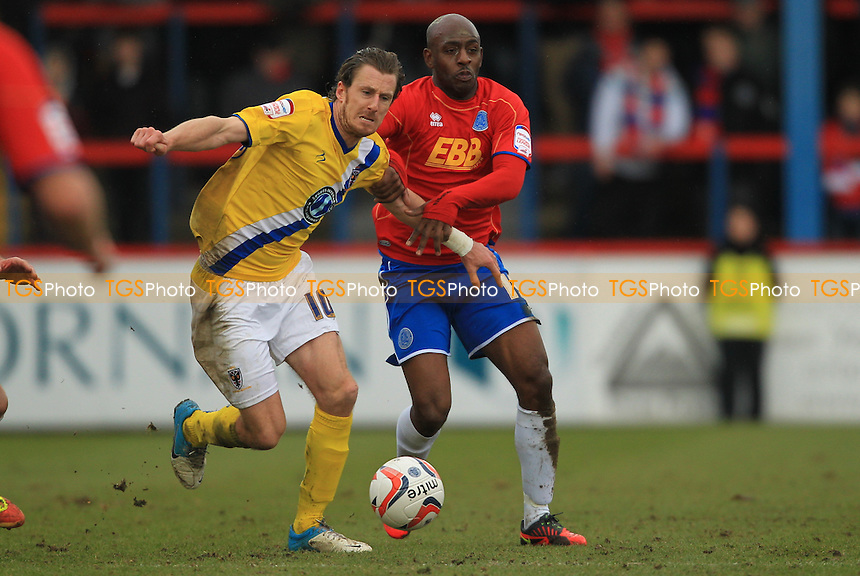 Jack Midson of AFC Wimbledon and Terrell Forbes of Aldershot Town - Aldershot Town vs AFC Wimbledon - NPower League Two Football at the Recreaton Ground, Aldershot, Hampshire - 16/03/13 - MANDATORY CREDIT: Simon Roe/TGSPHOTO - Self billing applies where appropriate - 0845 094 6026 - contact@tgsphoto.co.uk - NO UNPAID USE