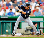 21 June 2011: Seattle Mariners pitcher Doug Fister lays down a sacrifice bunt against the Washington Nationals at Nationals Park in Washington, District of Columbia. The Nationals rallied from a 5-1 deficit, scoring 5 runs in the bottom of the 9th, to defeat the Mariners 6-5 in inter-league play. Mandatory Credit: Ed Wolfstein Photo