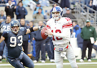 27 Nov 2005:   Seattle Seahawks defensive tackle #03 Craig Terrill races towards New York Giants quarterback Eli Manning  during the second quarter at Quest Field in Seattle, WA. at Quest Field in Seattle, WA.