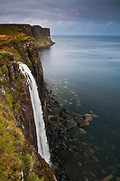 The Mealt Falls (foreground) and Kilt Rock, Isle of Skye, Scotland..South of Staffin, on the A855 coastal road, a viewpoint allows a magnificent sight over the Mealt Falls and Kilt Rock. This is one of the top tourist locations on the Trotternish area..The distinct rocky cliffs were formed during the Jurassic era, with horizontal sills of volcanic material pushed between older strata. The desintegration of the cliffs originates fragments with a peculiat cylindrical shape..The Mealt Falls drain the Loch Mealt nearby, famous for fishing and bird-watching.