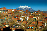 Mt Illimani overlooks crowded red brick houses in the city of El Alto.  El Alto is one of the highest major cities in the world, up to 13,615 feet above sea level.  Most of the population consists of indigenous Aymarans who have migrated from the countryside.