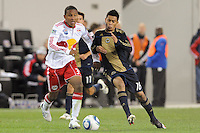 Juan Agudelo (39) of the New York Red Bulls is challenged by Michael Orozco (16) of the Philadelphia Union. The New York Red Bulls defeated the Philadelphia Union 2-1 during a US Open Cup qualifier at Red Bull Arena in Harrison, NJ, on April 27, 2010.