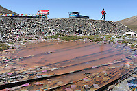A contaminated pool of water by the side of one of the major highways that runs through the northeastern region of the Tibetan Plateau. Development in the region is having severe environmental consequences.