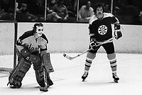 Seals Goalie Gilles Meloche, and Boston Bruins Derek Sanderson. (1973 photo by Ron Riesterer)