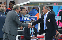 England Manager Roy Hodgson shakes hands with Uruguay manager Oscar Tabarez