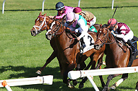 LEXINGTON, KY - April 09, 2017, #2 Projected (GB) and Joel Rosario (Pink Cap) win the 7th race, Allowance $78,000 for older horses, out finishing #6 Divisidero, #5 Pleuven (FR), and #3 Kaigun at Keeneland Race Course.  Lexington, Kentucky. (Photo by Candice Chavez/Eclipse Sportswire/Getty Images)