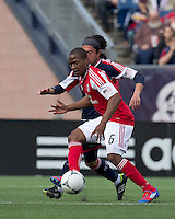Portland Timbers forward/midfielder Darlington Nagbe (6) at midfield passes the ball as New England Revolution midfielder Lee Nguyen (24) pressures. In a Major League Soccer (MLS) match, the New England Revolution defeated Portland Timbers, 1-0, at Gillette Stadium on March 24, 2012
