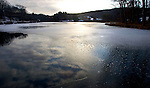 MIDDLEBURY, CT- 02 JAN 2008- 010208JT01-<br /> The sun sets over an icy Fenn's Pond in Middlebury on Wednesday afternoon. Temperatures in the area were below freezing on Wednesday and are forecast to continue to be cold into today.<br /> Josalee Thrift / Republican-American