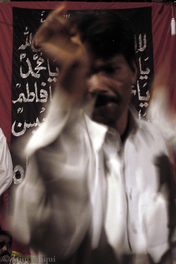 bari imam shrine, islamabad pakistan 2004: a man dances at an all night devotional music session. dance and music are used to help devotees achieve an ecstatic state of mind<br />