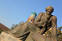 Oblique Low angle view of Statue of Muhammad ibn Musa Al-Khwarizmi (c.780-c.850), astronomer and mathematician, with the tower of Matniyaz Divan-begi Madrasah in the distance, Khiva, Uzbekistan, pictured on July 6, 2010, in the afternoon. Khiva, ancient and remote, is the most intact Silk Road city. Ichan Kala, its old town, was the first site in Uzbekistan to become a World Heritage Site(1991). Picture by Manuel Cohen.