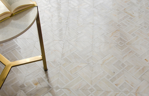 Delaunay, a hand-cut stone mosaic, shown in polished Cloud Nine and Dolomite, is part of the Palazzo collection by New Ravenna.