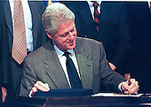 Washington, DC - November 12, 1999 -- U. S. President Bill Clinton signs S.900, the Financial Services Modernization Act of 1999 on 12 November, 1999.  This act replaces the depression-era Glass-Stegall Act.  <br /> Credit: Ron Sachs / CNP