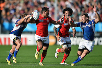 Siale Piutau of Tonga takes on the Namibia defence. Rugby World Cup Pool C match between Tonga and Namibia on September 29, 2015 at Sandy Park in Exeter, England. Photo by: Patrick Khachfe / Onside Images