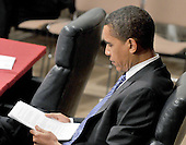 Washington, DC - April 8, 2008 -- United States Senator Barak Obama (Democrat of Illinois) reads his notes as he awaits the testimony of General David Petraeus and Ambassador Ryan Crocker before the United States Senate Foreign Relations Committee on the situation and progress in Iraq in Washington, D.C. on Tuesday, April 8, 2008..Credit: Ron Sachs / CNP