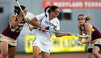 Kat Thomas (4) of Duke tries to control the ball in front of Sophia Gouraige (27) of Boston College during the first round of the ACC Women's Lacrosse Championship in College Park, MD.  Duke defeated Boston College, 17-6.