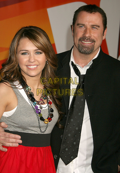 "MILEY CYRUS & JOHN TRAVOLTA.""Bolt"" Disney World Premiere held at the El Capitan Theatre, Hollywood, California, USA..November 17th, 2008.half length grey gray top black suit jacket belt tie goatee facial hair.CAP/ADM/MJ.©Michael Jade/AdMedia/Capital Pictures."
