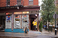 "Lima's Taste restaurant's signs announce it is open today, serving only drinks, seen in the Greenwich Village neighborhood in New York  on Monday, October 29, 2012. Hurricane Sandy continues its steady advance with heavy wind and rain. New York has shut down the schools, the transit system and the Holland and Hugh L. Carey Tunnels have been closed. Evacuations have been ordered in the ""Zone A"" areas including Battery park City. (© Frances M. Roberts)"