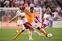 Jan Gunnar Solli (8) of the New York Red Bulls and Jermaine Taylor (4) of the Houston Dynamo look to play the ball. The New York Red Bulls defeated the Houston Dynamo 1-0 during a Major League Soccer (MLS) match at Red Bull Arena in Harrison, NJ, on May 09, 2012.