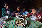 Children eat breakfast at their home in Tuixcajchis, a small Mam-speaking Maya village in Comitancillo, Guatemala. They are, from left, Griselda, 13; Lidia, 11; Elder, 6; and Nyda Diaz Vasquez, 3.