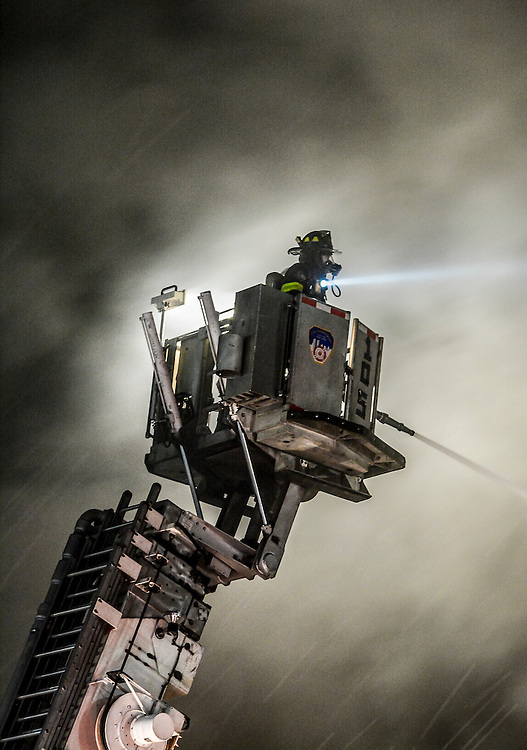 Tower Ladder 105 operates at a 5 alarm on Parkside Avenue in Brooklyn,A gas fed fire ripped through a 1 story commercial building in Lefferts Garden, Brooklyn on April 4,2016.