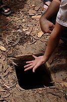Ho Chi Minh city<br /> , Vietnam - 2007 File Photo -<br /> <br />  soldier shows  trap door to  Cu Chi tunnels.<br /> <br /> <br /> <br /> <br /> photo : James Wong-  Images Distribution