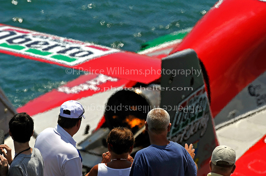 """Fans look on from the seawall as the U-1 """"Oh Boy! Oberto"""" and driver Steve David pulls away from the dock."""