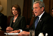 U.S. President George W. Bush (R) speaks to reporters at the top of a meeting with U.S. Congressional leaders, including Speaker of the House of Representatives Nancy Pelosi at the White House in Washington, D.C., USA on 11 September 2007. Bush planned to discuss the testimony of Army General David Petraeus on the Iraq war, among other issues.