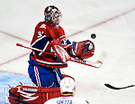 17 October 2009: Montreal Canadiens goaltender Carey Price makes a second period save against the Ottawa Senators at the Bell Centre in Montreal, Quebec, Canada. The Senators defeated the Canadiens 3-1. Mandatory Credit: Ed Wolfstein Photo