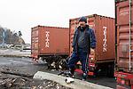 Fisherman Toshikazu Takahashi stands by cargo crates that he and fellow fishermen will use as temporary storage and processing units in Kyubunhama, Ishinomaki, Miyagi Prefecture, JapanPhotographer: Robert Gilhooly