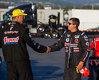 Feb 8, 2015; Pomona, CA, USA; NHRA pro stock driver Drew Skillman (right) congratulates race winner Jason Line during the Winternationals at Auto Club Raceway at Pomona. Mandatory Credit: Mark J. Rebilas-
