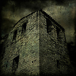 An ancient building under a dark sky
