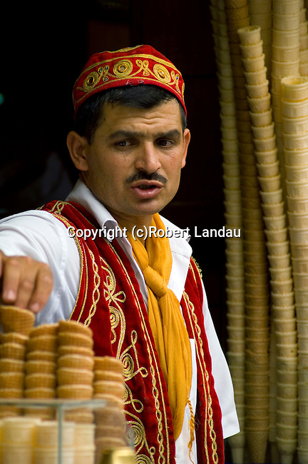 Turkish man in traditional costume vending ice cream cones in the Taksim district of Istanbul, turkey