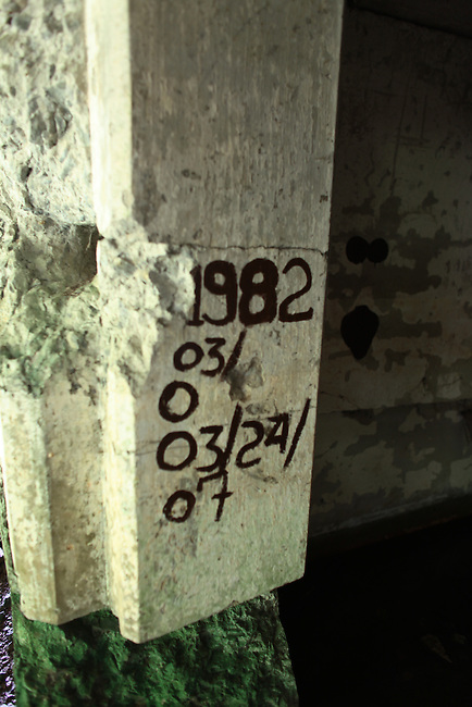Markings on a bunker on Corregidor island, the Philippines denote the dates when it was cleared of unexploded munitions left over from World War II. June 26, 2011.