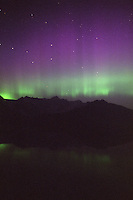 The aurora borealis, or northern lights, fill the sky above the Chugach Mountains and Prince William Sound near Whittier, Alaska.