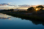 Wyoming, Powell. Heart Mountain and the irrigation canal near Powell Wyoming at sunset.