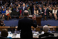 United States Senate Judiciary Committee Chairman Charles Grassley (Republican of Iowa), back to the camera, swears in Judge Neil Gorsuch during the first day of his Supreme Court confirmation hearing before the Senate Judiciary Committee in the Hart Senate Office Building on Capitol Hill March 20, 2017 in Washington, DC. Gorsuch was nominated by President Donald Trump to fill the vacancy left on the court by the February 2016 death of Associate Justice Antonin Scalia. <br /> Credit: Stephen Crowley / Pool via CNP /MediaPunch