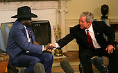 Washington, DC - January 5, 2009 -- United States President George W. Bush meets with Salva Kiir, First Vice President of the Government of National Unity of Sudan and President of the Government of Southern Sudan in the Oval Office on Monday, January 5, 2009..Credit: Dennis Brack - Pool via CNP
