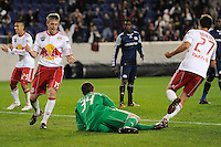 Connor Chinn (25), John Wolyniec (15) and Andrew Boyens (27) of the New York Red Bulls celebrate the team's second goal of the game as New England Revolution goalkeeper Bobby Shuttleworth (34) lays on the turf. The New York Red Bulls defeated the New England Revolution 3-0 during a U. S. Open Cup qualifier round match at Red Bull Arena in Harrison, NJ, on May 12, 2010.