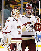 John Muse (BC - 1), Patrick Wey (BC - 6) - The Boston College Eagles defeated the Boston University Terriers 3-2 (OT) in their Beanpot opener on Monday, February 7, 2011, at TD Garden in Boston, Massachusetts.