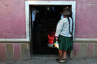 Woman buying coca leaves in a shop in Potosi, Bolivia