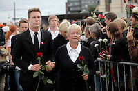 (Oslo July 25, 2011) AUF leader Eskil Pedersen arrives with former Prime Minister Gro Harlem Brundtland. An estimated 150,000 people gathered in Oslo town centre for a vigil following Friday's twin extremist attacks ...A large vehicle bomb was detonated near the offices of Norwegian Prime Minister Jens Stoltenberg on 22 July 2011. .Another terrorist attack took place shortly afterwards, where a man killed 68 people, mainly children and youths attending a political camp at Utøya island. ..Anders Behring Breivik was arrested on the island and has admitted to carrying out both attacks..(photo:Fredrik Naumann/Felix Features)